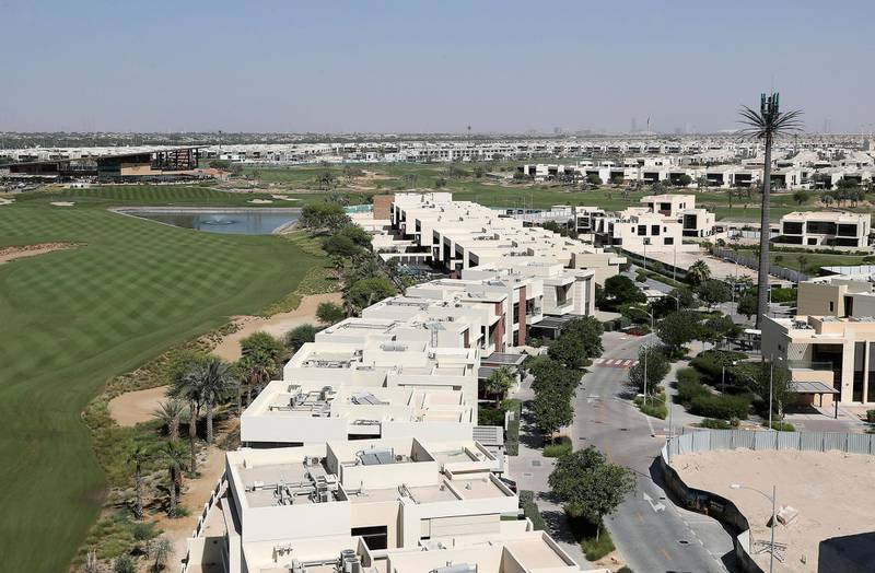 DUBAI, UNITED ARAB EMIRATES , October 26– 2020 :- View of the Trump International Golf Club (left) and villas (right) at the DAMAC Hills in Dubai. (Pawan Singh / The National) For News/Online/Stock. Story by Nick Webster