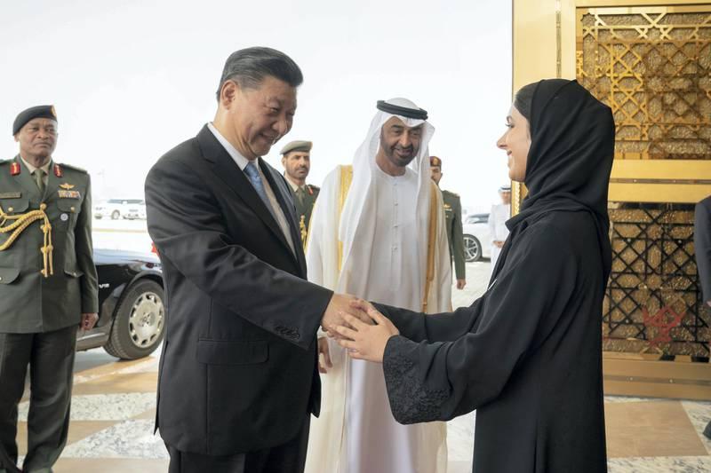 ABU DHABI, UNITED ARAB EMIRATES - July 21, 2018: HH Sheikha Meera bint Hazza bin Zayed Al Nahyan (R) bids farewell to HE Xi Jinping, President of China (2nd L), at the Presidential Airport. Seen with HH Sheikh Mohamed bin Zayed Al Nahyan, Crown Prince of Abu Dhabi and Deputy Supreme Commander of the UAE Armed Forces (C).  ( Mohamed Al Hammadi / Crown Prince Court - Abu Dhabi ) ---