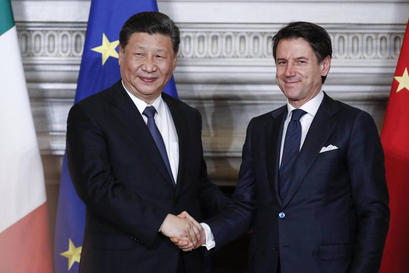 epaselect epa07458227 Italian premier Giuseppe Conte (R) shakes hands with Chinese President Xi Jinping during their meeting at the Villa Madama in Rome, Italy, 23 March 2019. President Xi Jinping is in Italy to sign a memorandum of understanding to make Italy the first Group of Seven leading democracies to join China's ambitious Belt and Road infrastructure project.  EPA/GIUSEPPE LAMI