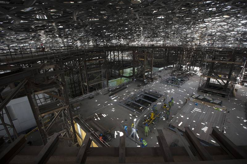 ABU DHABI, UNITED ARAB EMIRATES, May 28, 2015:   View of the inside of the Louvre Abu Dhabi's dome, which grows more intricate with each day, as its cladding is applied in layers, while the temporary scaffolding and steel structures beneath it are now being removed, as seen on Thursday, May 28, 2015, at the gallery's location on Saadiyat Island in Abu Dhabi.   (Silvia Razgova / The National)  (Usage: undated, RESTRICTED, Section: NA, Reporter: Nick Leech) *** Local Caption ***  SR-150528-LAD0275.jpg