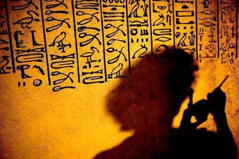 """An employee of the Westlausitz museum paints hieroglyphics on the wall of a reproduced Egyptian grave-chamber in preparation of the exhibition """"Ex Oriente Lux - Treasures from Private Collections from the Oberlausitz"""" on June 23, 2010 in Kamenz, eastern Germany. From June 26, 2010 to April 10, 2011, the museum presents art objects and treasures from Asia and the Mediterranean.      AFP PHOTO    ARNO BURGI    GERMANY OUT"""