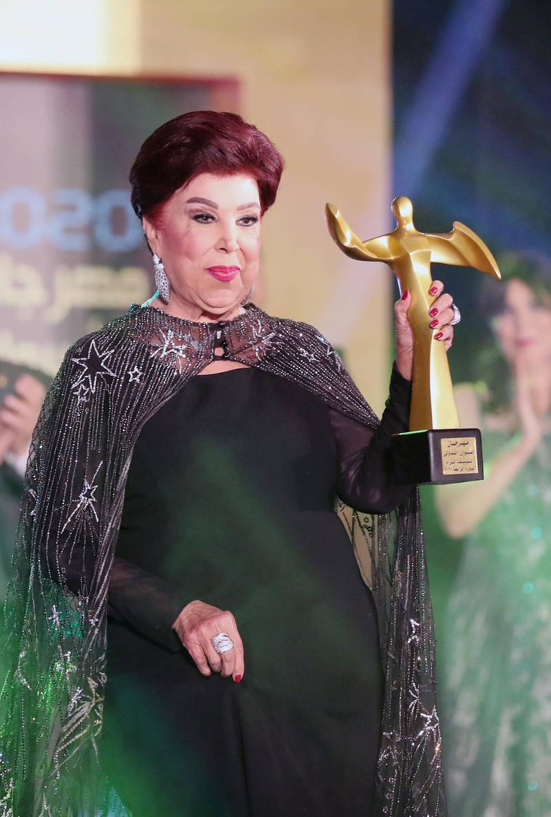 epa08209679 Egyptian actress Ragaa El Geddawy receives an award during the opening ceremony of the 4th Aswan International Women Film Festival, in Aswan, Egypt, 10 February 2020. The AIWFF runs from 10 to 15 February.  EPA-EFE/KHALED ELFIQI *** Local Caption *** 55866041