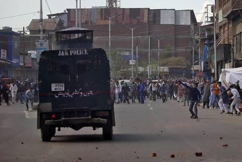 Kashmiri demonstrators throw pieces of bricks and stones towards an Indian police vehicle during a protest after Jumat-ul-Vida or the last Friday prayers of the holy fasting month of Ramadan, in Srinagar May 31, 2019. REUTERS/Danish Ismail