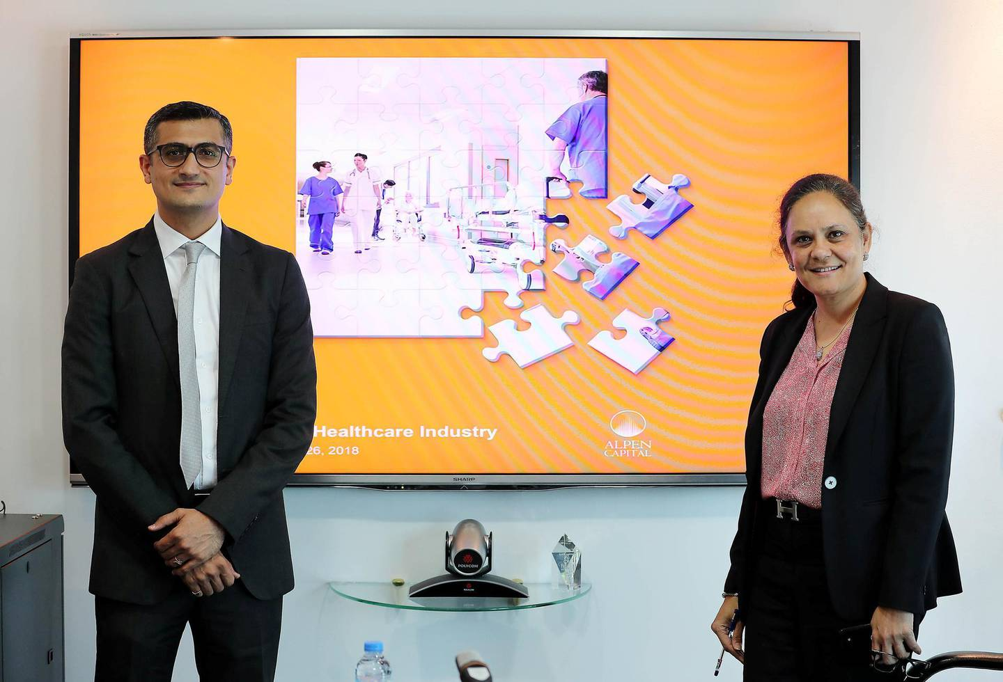 DUBAI , UNITED ARAB EMIRATES , MARCH 26  – 2018 :- Left to Right -  Krishna Dhanak , Executive Director , Alpen Capital (ME Ltd) and Sameena Ahmad , Managing Director , Alpen Capital (ME Ltd)  during the roundtable press conference about Healthcare Industry held at Alpen Capital office in DIFC in Dubai. ( Pawan Singh / The National ) For News. Story by Nick