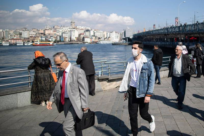 epa08285661 A man wearing a face mask walks near the Bosphorus in Istanbul, Turkey, 11 March 2020. Turkish Health Minister Fahrettin Koca has announced the first coronavirus COVID-19 case in Turkey. A male patient has tested positive to the virus and has been isolated.  EPA/ERDEM SAHIN