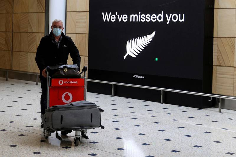 FILE PHOTO: A passenger arrives from New Zealand after the Trans-Tasman travel bubble opened overnight, following an extended border closure due to the coronavirus disease (COVID-19) outbreak, at Sydney Airport in Sydney, Australia, October 16, 2020. REUTERS/Loren Elliott/File Photo