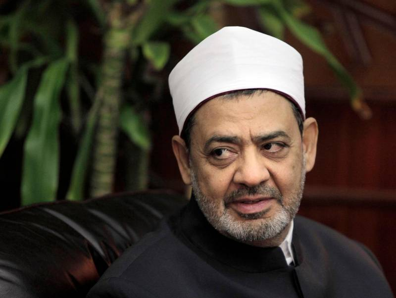 """FILE - In this Aug. 8, 2011 file photo, Ahmed al-Tayeb, Grand Sheikh of Al-Azhar, Egypt's top Muslim cleric, meets with Egyptian presidential candidate Mohamed El Baradei, in Cairo, Egypt. Al-Tayeb has stirred up controversy after saying that polygamy is an """"injustice"""" for women. His comments, aired Friday, Feb. 1, 2019, on state TV said """"those who say that marriage must be polygamous are all wrong."""" He said polygamy is restricted in Islam and requires fairness. (AP Photo/Amr Nabil, File)"""