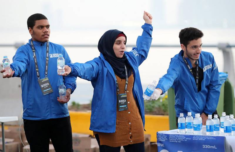 Abu Dhabi, United Arab Emirates - December 06, 2019: Water and energy drinks are handed out in the ADNOC Abu Dhabi marathon 2019. Friday, December 6th, 2019. Abu Dhabi. Chris Whiteoak / The National
