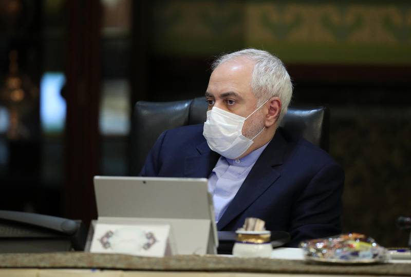 """A handout picture provided by the Iranian presidency on March 11, 2020 shows Iranian Foreign Minister Mohmmad Javad Zarif wearing a protective mask as a means of protection against the cornonavirus COVID-19, during a cabinet meeting in the capital Tehran. - Iran otoday reported 63 new deaths from the novel coronavirus in the past 24 hours, the highest single-day toll since it announced the first deaths from the outbreak. The novel coronavirus outbreak in Iran is one of the deadliest outside of China and has so far killed 291 people and infected more than 8,000. (Photo by - / Iranian Presidency / AFP) / === RESTRICTED TO EDITORIAL USE - MANDATORY CREDIT """"AFP PHOTO / HO / IRANIAN PRESIDENCY"""" - NO MARKETING NO ADVERTISING CAMPAIGNS - DISTRIBUTED AS A SERVICE TO CLIENTS ==="""