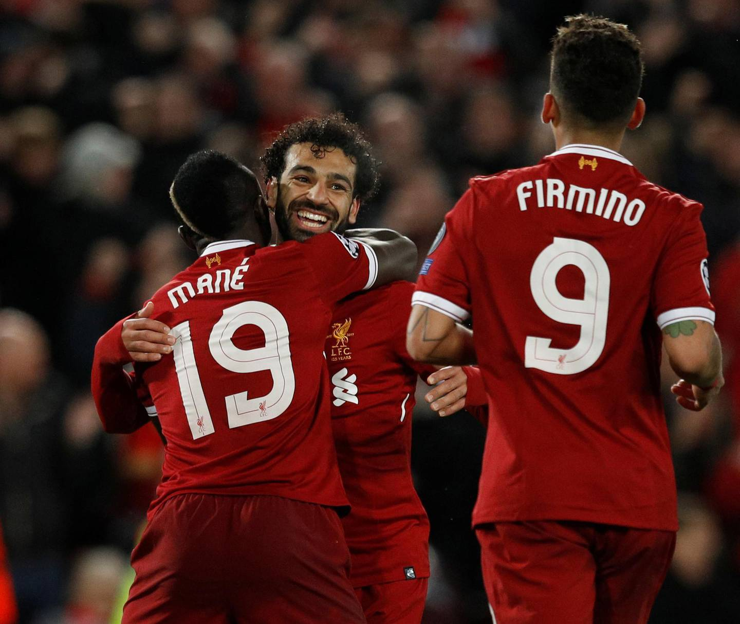 Soccer Football - Champions League Semi Final First Leg - Liverpool vs AS Roma - Anfield, Liverpool, Britain - April 24, 2018   Liverpool's Sadio Mane celebrates scoring their third goal with Mohamed Salah and Roberto Firmino    REUTERS/Phil Noble - RC1E9F88F4C0