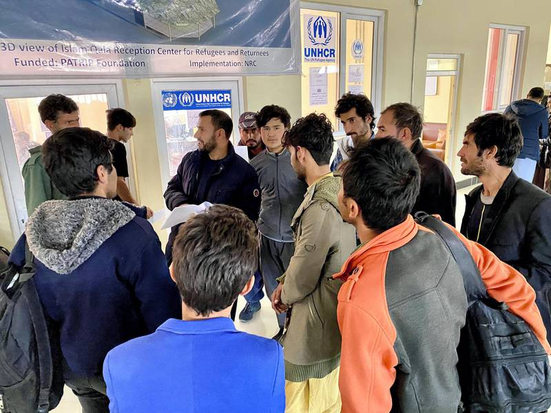 IMG_0799: Newly arrived Afghan deportees from Iran gather outside the office of UNHCR in the Reception Center for Refugees and Returnees in Islam Qala on the western border of Afghanistan. [Photo: Hikmat Noori]