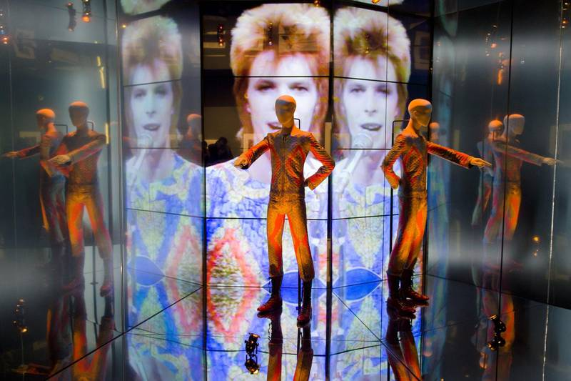 """The """"Starman"""" costume from David Bowie's appearance on """"Top of the Pops"""" in 1972 is displayed at the """"David Bowie is"""" exhibition at the Victoria and Albert (V&A) museum in central London on March 20, 2013. Running March 23 to August 11, the exhibition features more than 300 objects that include handwritten lyrics, original costumes, fashion, photography, film, music videos, set designs and Bowie's own instruments.  AFP PHOTO/Leon Neal (Photo by LEON NEAL / AFP)"""