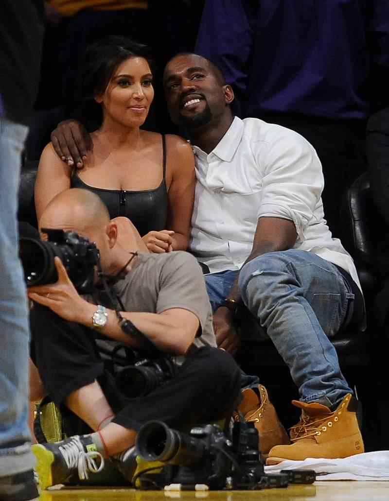 epa03216826 US celebutante Kim Kardashian (L) and US singer Kanye West (R) attend the Denver Nuggets against Los Angeles Lakers game seven of the Western Conference quarterfinals at the Staples Center in Los Angeles, California, USA, 12 May 2012.  EPA/MICHAEL NELSON CORBIS OUT