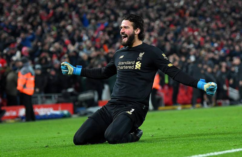 LIVERPOOL, ENGLAND - JANUARY 19: Alisson Becker of Liverpool celebrates victory after the Premier League match between Liverpool FC and Manchester United at Anfield on January 19, 2020 in Liverpool, United Kingdom. (Photo by Michael Regan/Getty Images)