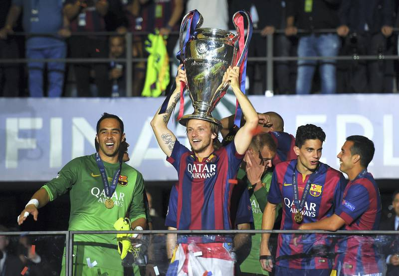 BERLIN, GERMANY - JUNE 06: Ivan Rakitic of Barcelona celebrates victory with the trophy after the UEFA Champions League Final between Juventus and FC Barcelona at Olympiastadion on June 6, 2015 in Berlin, Germany.  (Photo by Shaun Botterill/Getty Images)