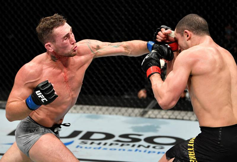 ABU DHABI, UNITED ARAB EMIRATES - JULY 26: (L-R) Darren Till of England punches Robert Whittaker of New Zealand in their middleweight fight during the UFC Fight Night event inside Flash Forum on UFC Fight Island on July 26, 2020 in Yas Island, Abu Dhabi, United Arab Emirates. (Photo by Jeff Bottari/Zuffa LLC via Getty Images) *** Local Caption *** ABU DHABI, UNITED ARAB EMIRATES - JULY 26: (L-R) Darren Till of England punches Robert Whittaker of New Zealand in their middleweight fight during the UFC Fight Night event inside Flash Forum on UFC Fight Island on July 26, 2020 in Yas Island, Abu Dhabi, United Arab Emirates. (Photo by Jeff Bottari/Zuffa LLC via Getty Images)