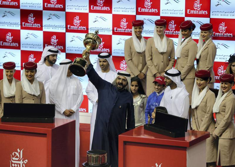 DUBAI, UNITED ARAB EMIRATES - MARCH 29:  Sheikh Mohammed bin Rashid Al Maktoum, Ruler of Dubai and Vice President of the UAE rejoices after winning the Dubai World Cup with his horse African Story ridden by Silvestre De Sousa during the Dubai World Cup  at the Meydan Racecourse on March 29, 2014 in Dubai, United Arab Emirates.  (Photo by Francois Nel/Getty Images)