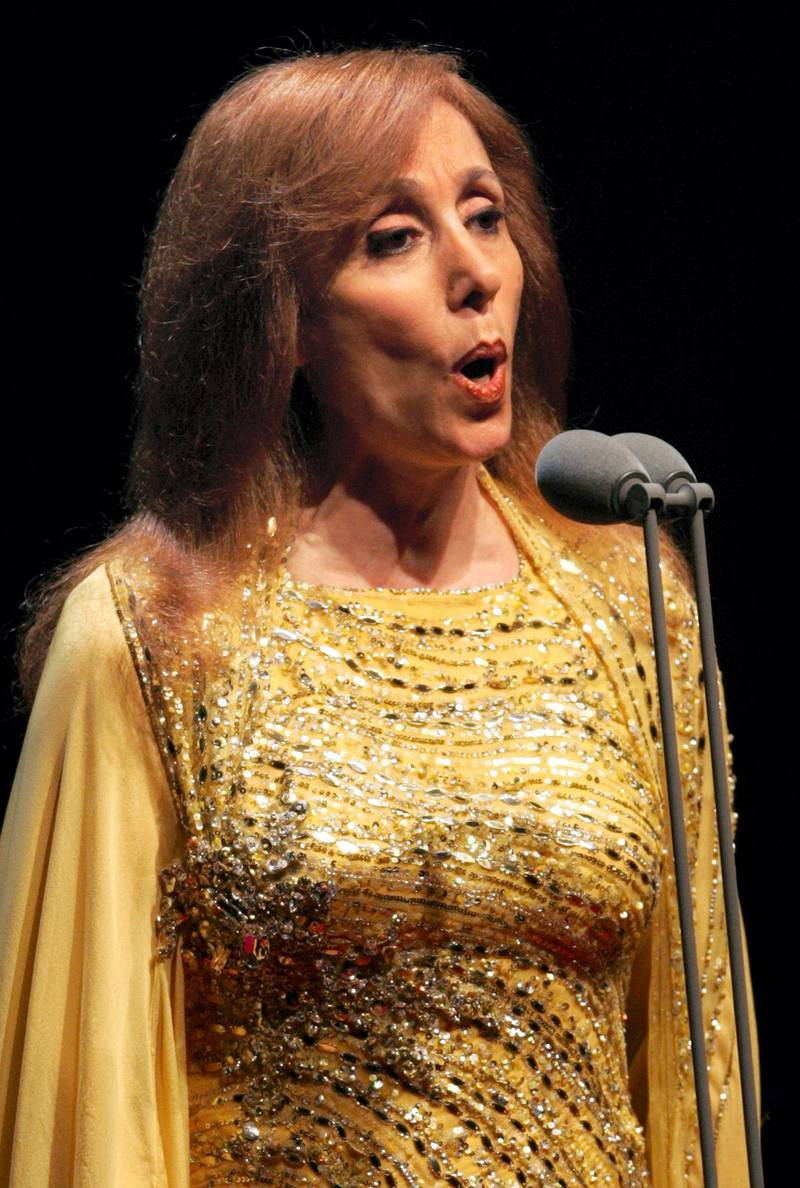 Lebanese diva Fairuz performs at the American University concert hall in Dubai, 30 March 2006. Marking her first concert of the year, the legendary singer was accompanied by her mixed Armenian and Lebanese orchestra, conducted by Karen Durgarian. The concert, Fairuz's first in Gulf since 2003, was held to raise funds for the Gulf emirate's Autism Center. AFP PHOTO/RABIH MOGHRABI / AFP PHOTO / RABIH MOGHRABI