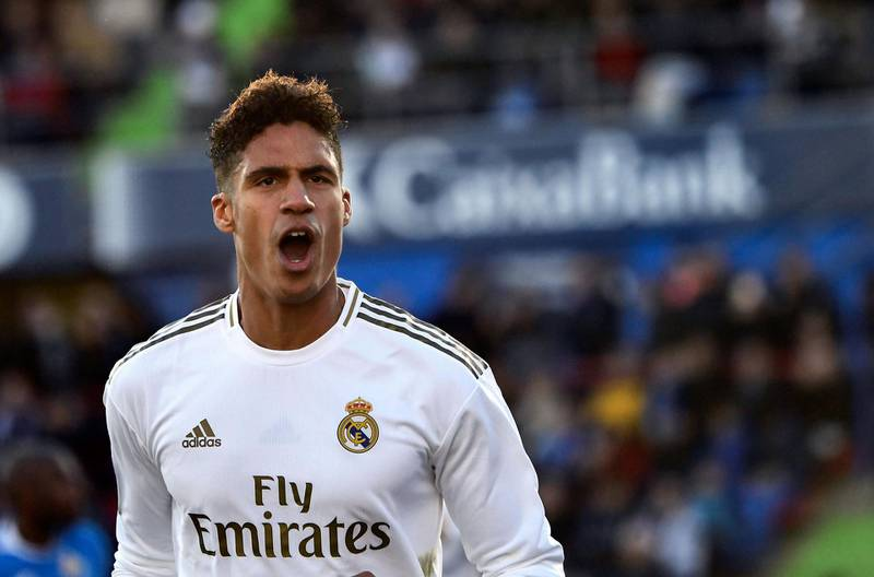 Real Madrid's French defender Raphael Varane celebrates his goal during the Spanish league football match between Getafe CF and Real Madrid CF at the Col. Alfonso Perez stadium in Getafe on January 4, 2020. / AFP / OSCAR DEL POZO