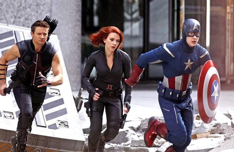 Jeremy Renner, from left, Scarlett Johansson and Chris Evans in the Avengers. CREDIT: Marvel Studios *** Local Caption ***  al26ap-holly-Sorry-p6.jpg