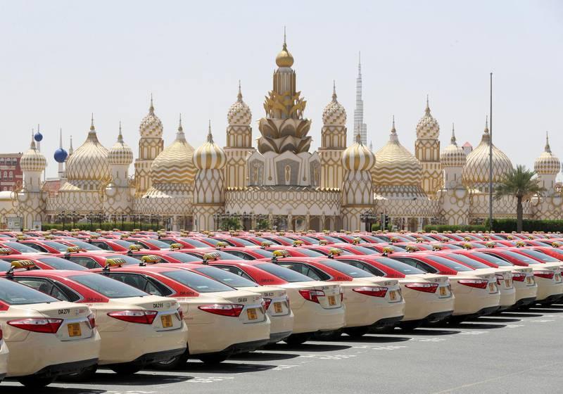 Dubai, United Arab Emirates - Reporter: N/A: A lot of taxi's sit outside Global Village. Wednesday, April 1st, 2020. Dubai. Chris Whiteoak / The National