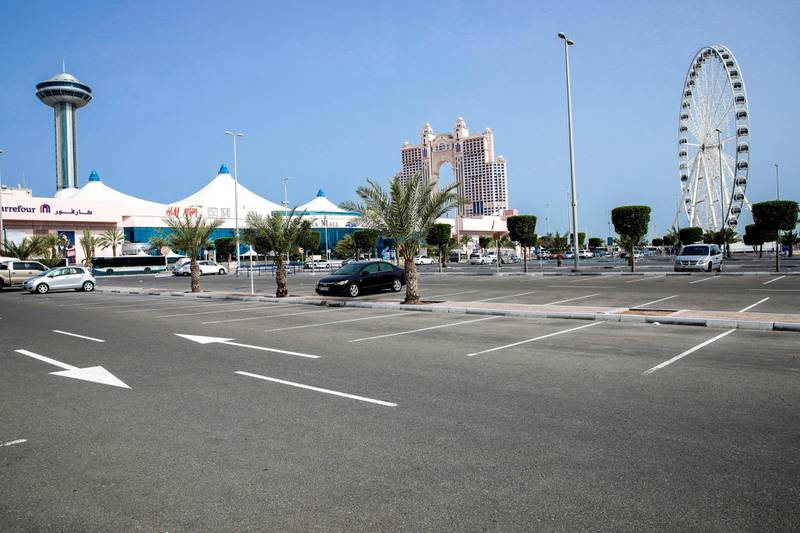 Abu Dhabi, United Arab Emirates, March 27, 2020.   The nearly empty parking lot at the Marina Mall on the first day of the UAE cleaning campaignEmiratis and residents across the UAE must stay home this weekend while a nationwide cleaning and sterilisation drive is carried out. Victor Besa / The National