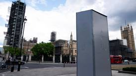 Churchill statue's protective box could come off for Macron's London visit