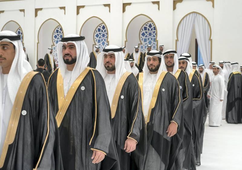 ADHAN, RAS AL KHAIMAH, UNITED ARAB EMIRATES - March 13, 2018: Grooms participate during a mass wedding reception for HH Sheikh Mohamed bin Saud bin Saqr Al Qasimi, Crown Prince and Deputy Ruler of Ras Al Khaimah (not shown), at Mohamed bin Zayed, Al Bayt Mitwahid wedding hall.   ( Mohamed Al Hammadi / Crown Prince Court - Abu Dhabi ) ---