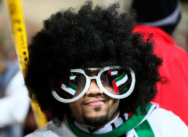 An Emirati fan cheers prior to the start of the 21st Gulf Cup final football match between United Arab Emirates and Iraq in Manama, on January 18, 2013. AFP PHOTO/MARWAN NAAMANI   *** Local Caption ***  288884-01-08.jpg sp19ja-UAEFans2.jpg na19ja-UAEFansBahrain.jpg