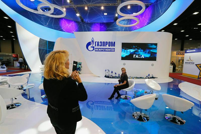 epa06242048 Visitors take photographs at the Gazprom booth during the international specialised exhibition 'InGas Stream 2017 - Innovations in the Gas Industry' at the 7th St. Petersburg International Gas Forum in St.Petersburg, Russia, 03 October 2017.  EPA/ANATOLY MALTSEV