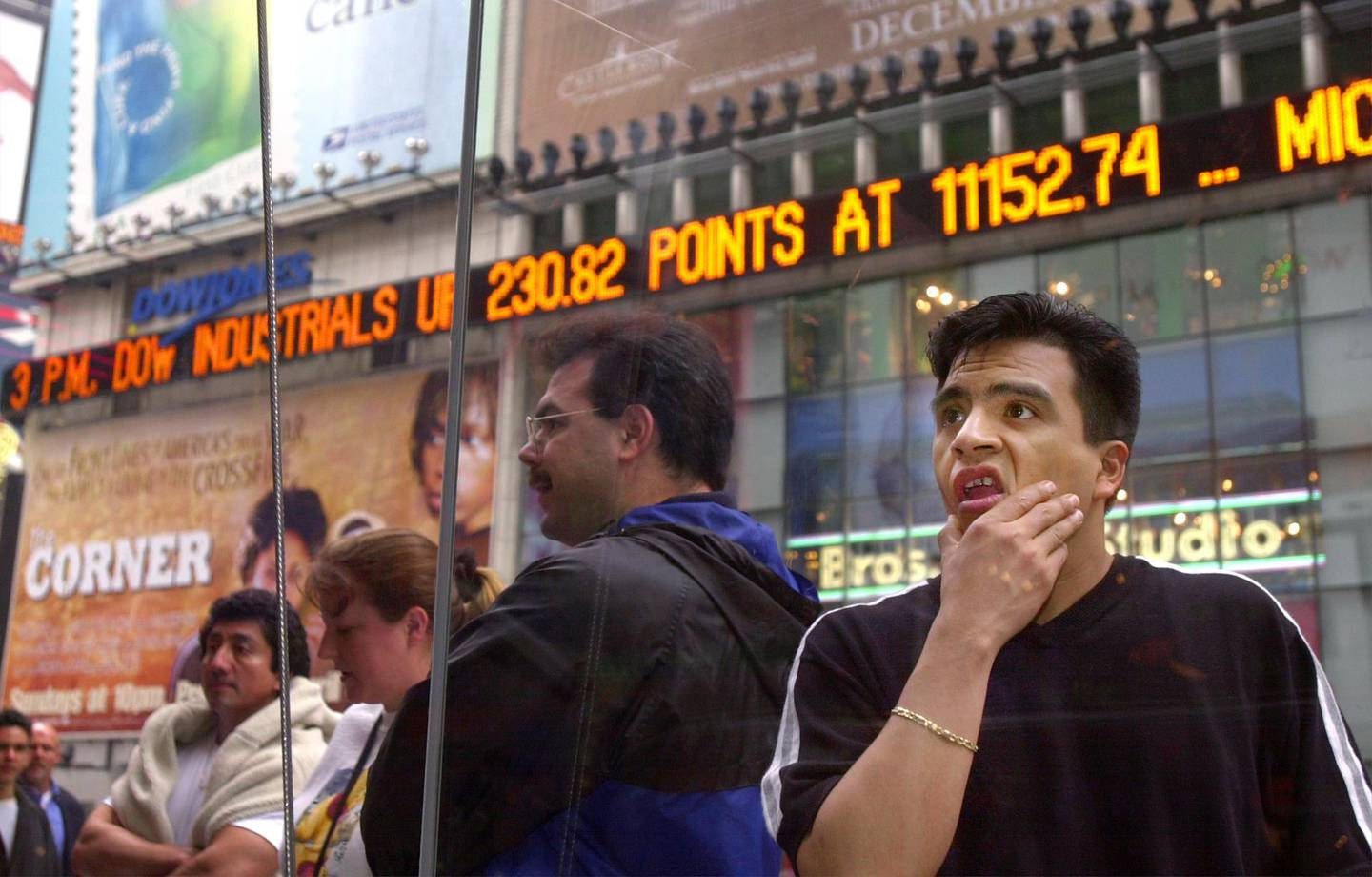 N366994 05: A passer-by looks over the prices on the Nasdaq board in Times Square in New York, April 3, 2000. The Nasdaq plummeted 349 points to 4225.25 Monday, the fifth-biggest one-day loss in percentage terms in its history. Microsoft shares plummeted on news that attempts to settle the U.S. federal government's antitrust lawsuit broke down over the weekend. (Photo by Chris Hondros)