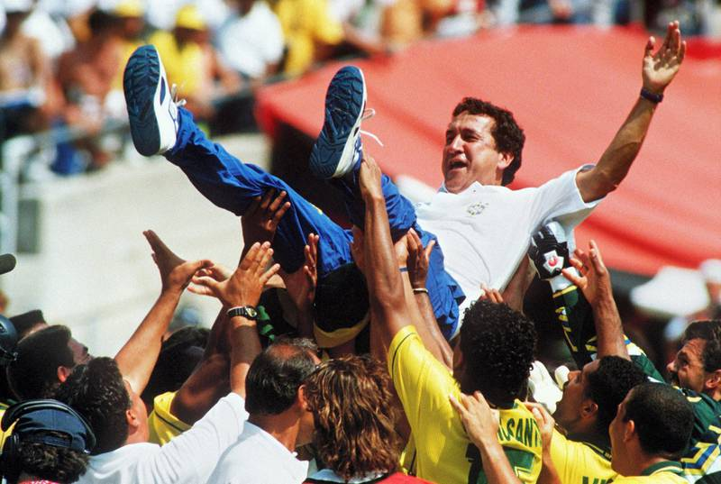 Brazilian coach Carlos Parreira is thrown up in the air by his players after Brazil defeated Italy 3-2 in the shoot-out session (0-0 after extra time) at the end of the World Cup final 17 July 1994 at he Rose Bowl in Pasadena. AFP PHOTO/GABRIEL BOUYS / AFP PHOTO / GABRIEL BOUYS