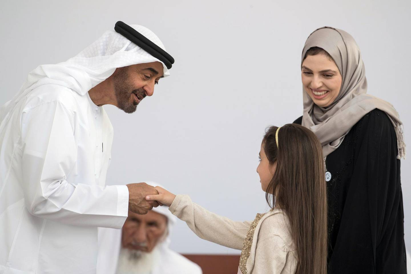 ABU DHABI, UNITED ARAB EMIRATES -  March 12, 2018: HH Sheikh Mohamed bin Zayed Al Nahyan, Crown Prince of Abu Dhabi and Deputy Supreme Commander of the UAE Armed Forces (L), presents an Abu Dhabi Award to Layan Al Zoebie (C) and Dr Lama Al Zoebie (R), who are receiving the award on behalf of their late father, Dr Azzam Al Zoebie (not shown) during the awards ceremony at the Sea Palace. ( Ryan Carter for the Crown Prince Court - Abu Dhabi ) ---