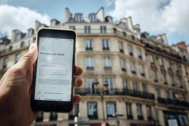 The Airbnb Inc. app is displayed on a Apple Inc. smartphone near residential apartments in this arranged photograph in Paris, France, on Wednesday, June 10, 2020. France slammed the U.S. over its probe intodigitaltaxes that are being considered by a number of countries, saying it contradicts Washington's call for unity among leading economies. Photographer: Cyril Marcilhacy/Bloomberg