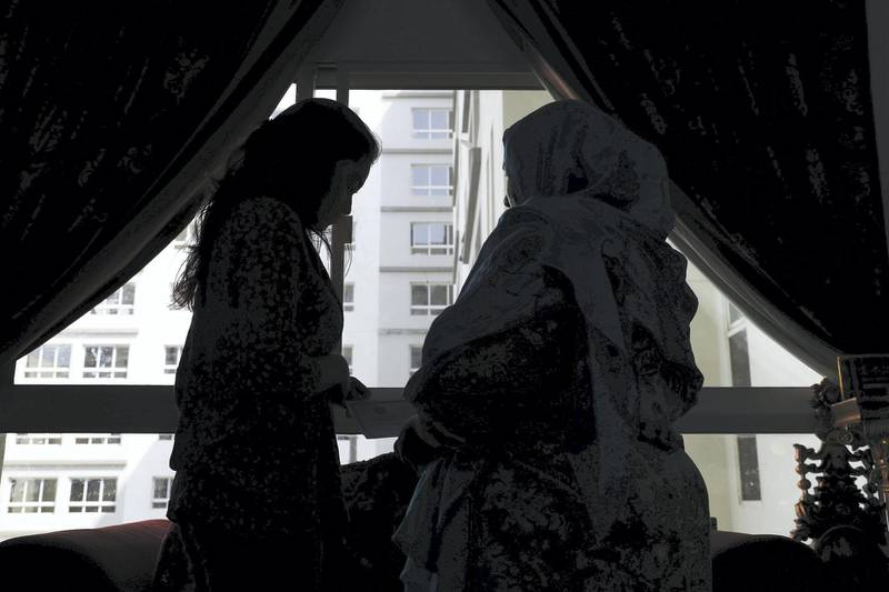 DUBAI , UNITED ARAB EMIRATES ,  October 25 , 2018 :- Azliya���s ( 46 years old right side) with one of her teenage daughter SS ( left ) at her home in Dubai. Azliya is from Sri Lanka and trying to regularise her status. ( Pawan Singh / The National )  For News. Story by Ramola
