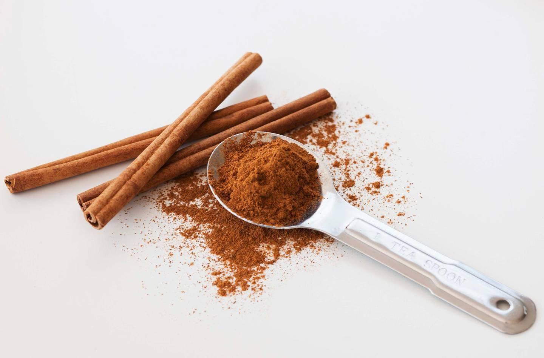 Studio shot of cinnamon stick and cinnamon powder. Getty Images
