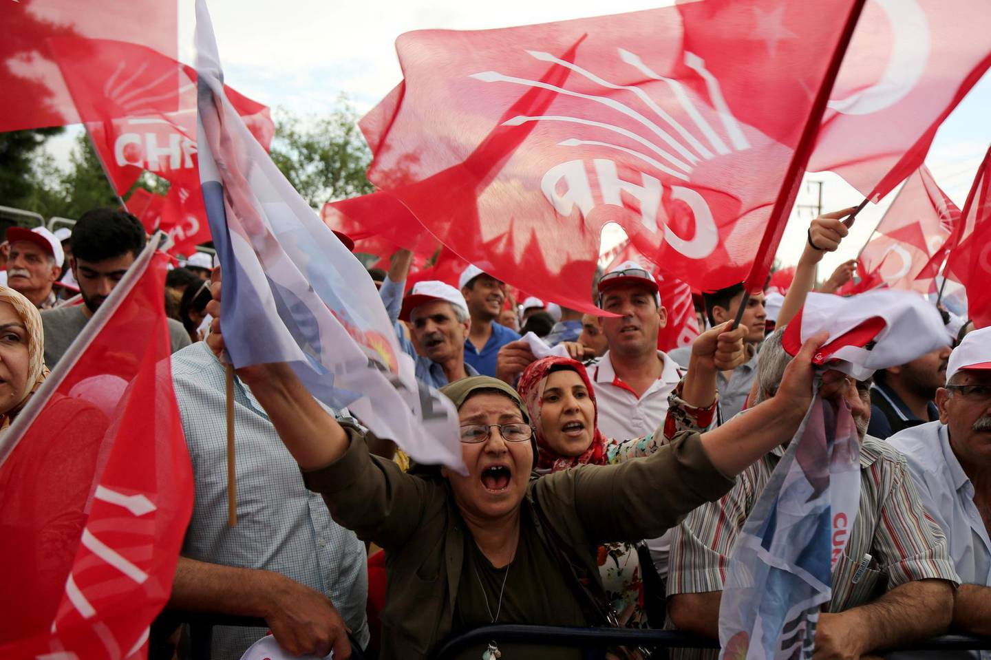 Supporters of Muharrem Ince, presidential candidate of the main opposition Republican People's Party (CHP), wave Turkish and party flags during an election rally in Diyarbakir, Turkey June 11, 2018. REUTERS/Sertac Kayar