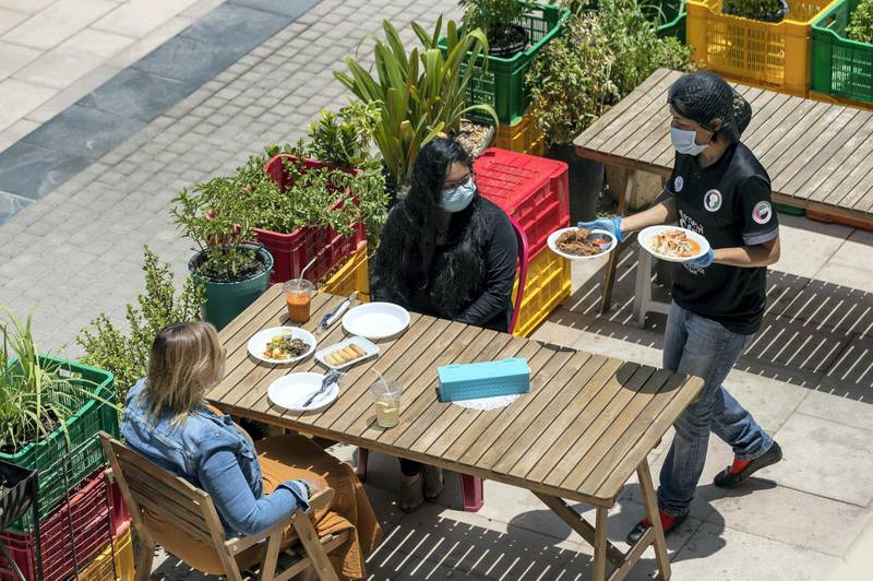 Dubai, United Arab Emirates - Reporter: N/A. Coronavirus/Covid-19. People have lunch at Cafe Isan in JLT on a sunny day in Dubai. Monday, June 8th, 2020. Dubai. Chris Whiteoak / The National