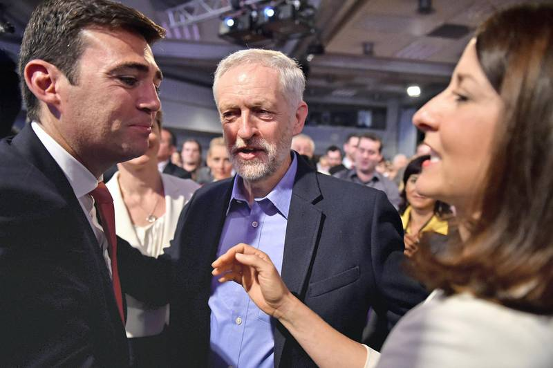 LONDON, ENGLAND - SEPTEMBER 12:  Jeremy Corbyn (C) is announced as the new leader of the Labour Party at the Queen Elizabeth II conference centre on September 12, 2015 in London, England. Mr Corbyn was announced as the new Labour leader today following three months of campaigning against fellow candidates minister Andy Burnham (L) and shadow minister Liz Kendall (R). The leadership contest comes after Ed Miliband's resignation following the general election defeat in May. (Photo by Jeff J Mitchell/Getty Images)