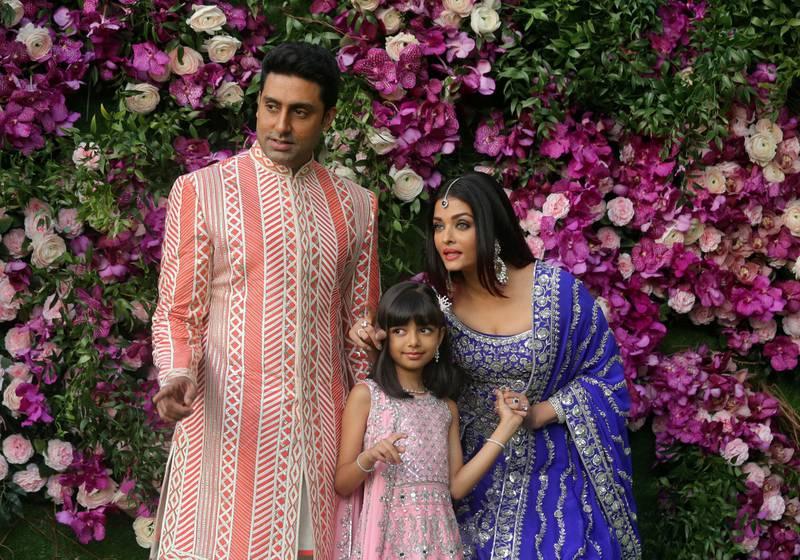 FILE PHOTO: Indian film actor Abhishek Bachchan, his wife Aishwarya Rai and their daughter Aaradhya in a 2019 photograph taken at the wedding of  Akash Ambani, the son of Reliance Industries chairman Mukesh Ambani, in Mumbai, India. Picture taken on March 9, 2019. REUTERS/Francis Mascarenhas/File Photo