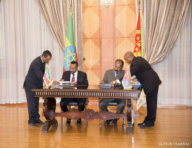 Ethiopia's Prime minister Abiy Ahmed and Eritrean President Isaias Afwerk sign a declaration in Asmara, Eritrea July 9, 2018 in this photo obtained from social media on July 10, 2018. GHIDEON MUSA ARON VISAFRIC/via REUTERS THIS IMAGE HAS BEEN SUPPLIED BY A THIRD PARTY. NO RESALES. NO ARCHIVES. MANDATORY CREDIT.