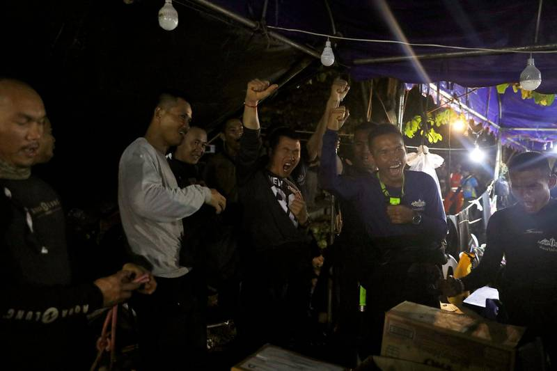Thailand's Navy Seal celebrating  near the Tham Luang cave complex, as members of under-16 soccer team and their coach have been found alive according to a local media's report  in the northern province of Chiang Rai, Thailand, July 2, 2018. REUTERS/Soe Zeya Tun