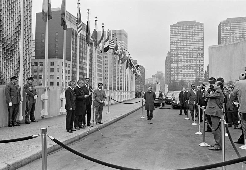 The Secretary-General is seen here as he read a statement prior to the flag-raising. From left to right are: Adam Malik, President of the tventy-sixth session of the General Assembly; Secretary-General, U Thant; Adnan Pachachi, Minister of State of the United Arab Emirates (UAE) and Chairman of the delegation; and Mohamed Abdul Latif, Director of the Department of International Organizations of the Ministry of Foreign Affairs of that country.10 December 1971. UN Photo/Saw Lwin
