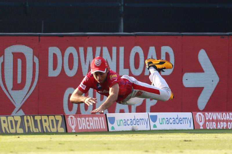 Ravi Bishnoi of Kings XI Punjab dives to stop the four during match 53 of season 13 of the Dream 11 Indian Premier League (IPL) between the Chennai Super Kings and the Kings XI Punjab at the Sheikh Zayed Stadium, Abu Dhabi  in the United Arab Emirates on the 1st November 2020.  Photo by: Vipin Pawar  / Sportzpics for BCCI