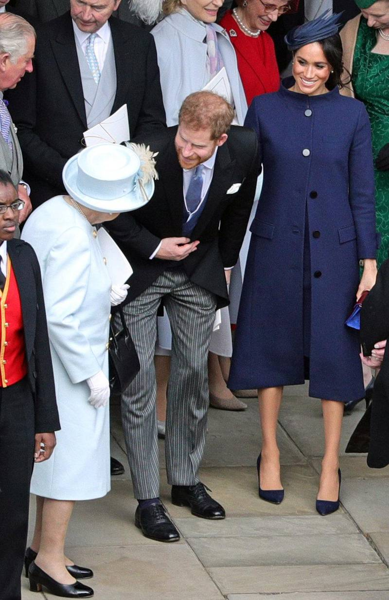 WINDSOR, ENGLAND - OCTOBER 12: Queen Elizabeth II speaks with the Duke and Duchess of Sussex outside St George's Chapel in Windsor Castle, following the wedding of Princess Eugenie to Jack Brooksbank on October 12, 2018 in Windsor, England. (Photo by Aaron Chown - WPA Pool/Getty Images)