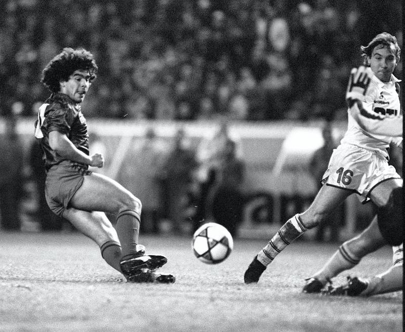 Picture showing Argentinian soccer player Diego Maradona wearing the color of FC Barcelone, during a friendship match against Paris Saint Germain,13 November 1982, in Paris. (Photo by JOEL ROBINE / AFP)