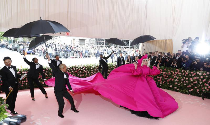 epa07552047 Lady Gaga arrives on the red carpet for the 2019 Met Gala, the annual benefit for the Metropolitan Museum of Art's Costume Institute, in New York, New York, USA, 06 May 2019. Pink dress by Brandon Maxwell. The event coincides with the Met Costume Institute's new spring 2019 exhibition, 'Camp: Notes on Fashion', which runs from 09 May until 08 September 2019.  EPA-EFE/JUSTIN LANE