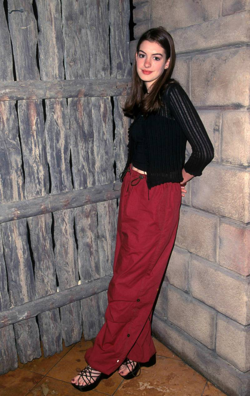 Anne Hathaway At The Fox Teen Press Junket Planet Hollywood In Los Angeles, CA 07-23-1999. Credit: 3553583Globe Photos/MediaPunch /IPX