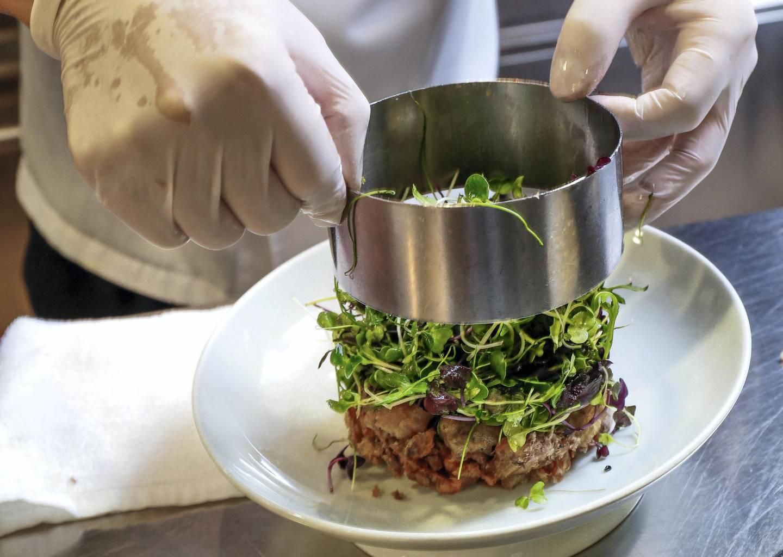 Abu Dhabi, UAE.  March, 12,  2018. Hakkasan Executive Chef, Lee Kok Hua, demonstrates on how to make Crispy Duck Salad.Victor Besa / The NationalWeekendReporter:  Mel Healy