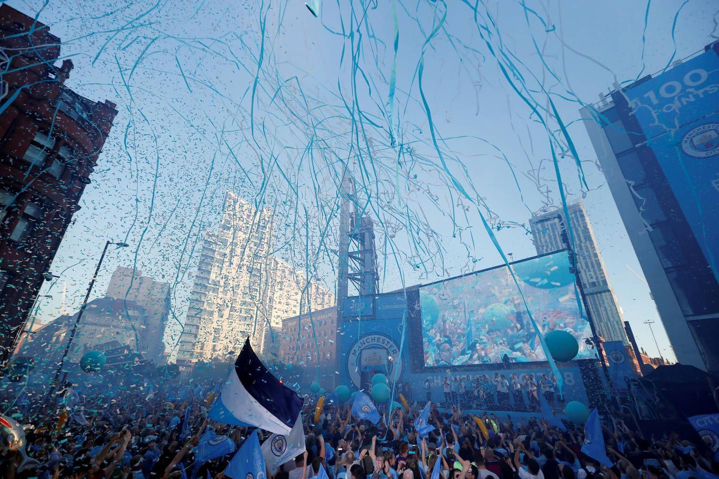 FILE PHOTO: ON THIS DAY -- May 14   May 14, 2018     SOCCER - Manchester City fans and players celebrate during the parade after the club clinched the Premier League title with a record haul of 100 points.     No team had ever accumulated 100 points in a season and Pep Guardiola's City nearly lost their chance in the final game against Southampton a day earlier before Gabriel Jesus scored an stoppage-time winner in a 1-0 win.     The title was City's second of the season after they won the League Cup in February. Action Images via REUTERS/Andrew Boyers/File photo